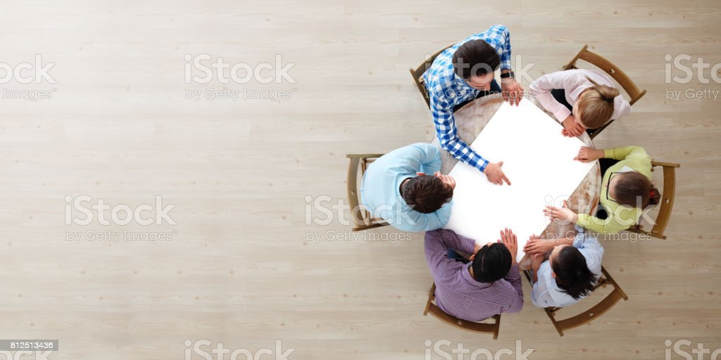 People team pointing to white paper stock photo