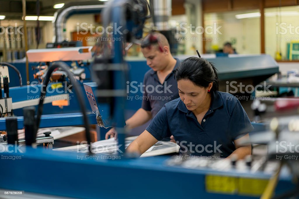 People textile printing at a factory stock photo
