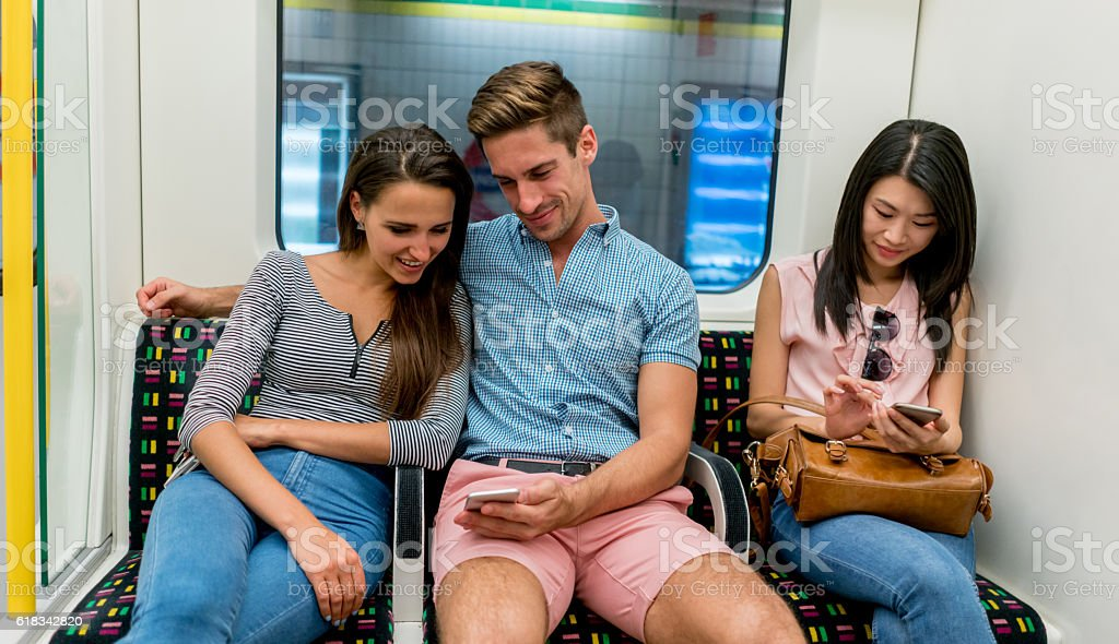 People texting while riding the metro stock photo