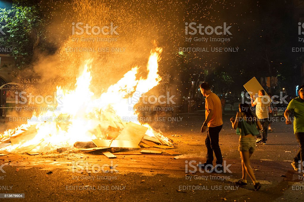 People throwing objects at a bonfire, Barcelona stock photo