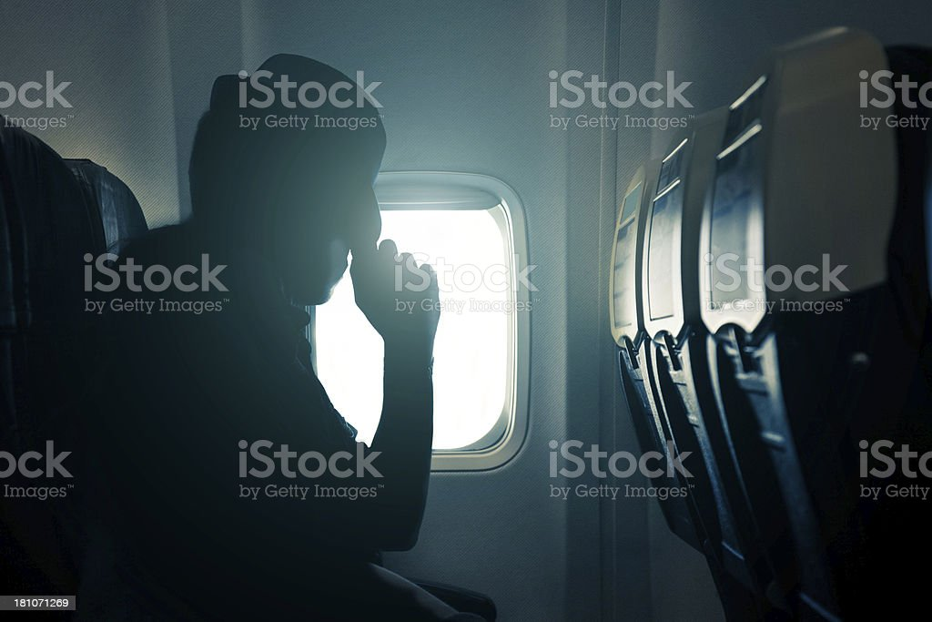 People tired during airplane travel stock photo