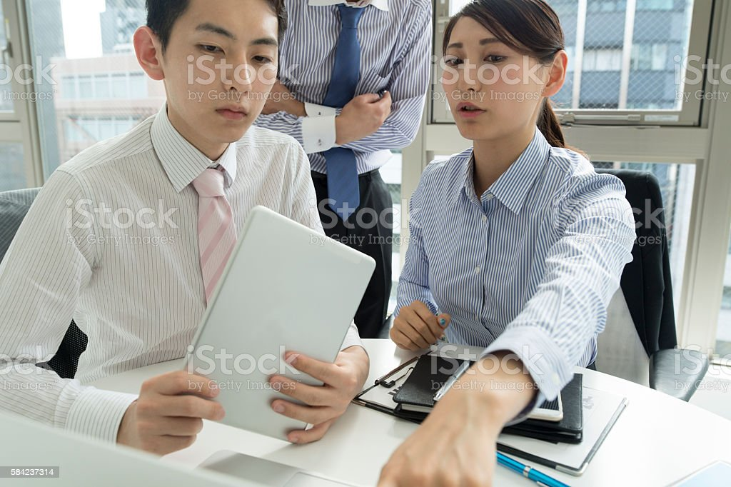 People to the conference while looking at the personal computer. stock photo
