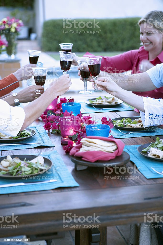 People toasting with wine at dinner party royalty-free stock photo