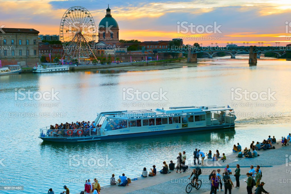 People Toulouse river embankment. France stock photo