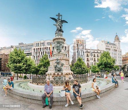 13 JULY 2018, ZARAGOZA, SPAIN: People, tourists at the Spain Square in Zaragoza resting near fountain