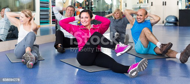 istock people training in a gym on sport mats 638594278