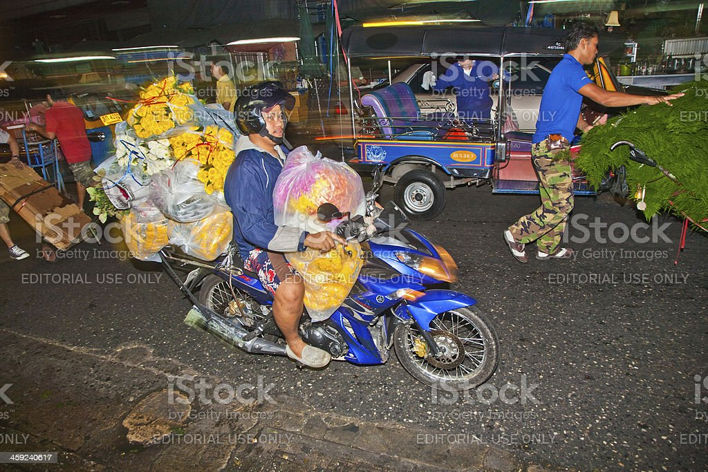 people transport flowers at Pak Khlong Thalat market royalty-free stock photo