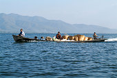 istock People transporting goods on a canoe at lake Inle 523258735