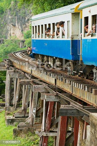 Kanchanaburi, Thailand - June 16, 2011: Unidentified people travel with the vintage train by the Death railway in Kanchanaburi, Thailand.