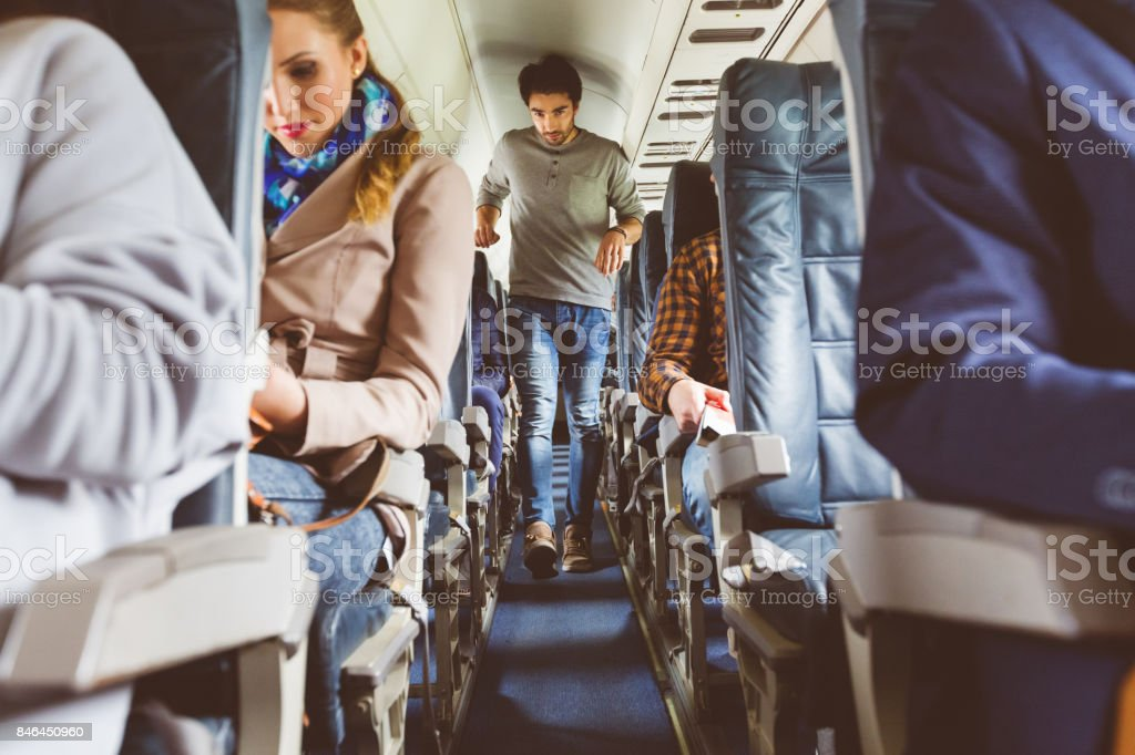 People traveling by airplane stock photo
