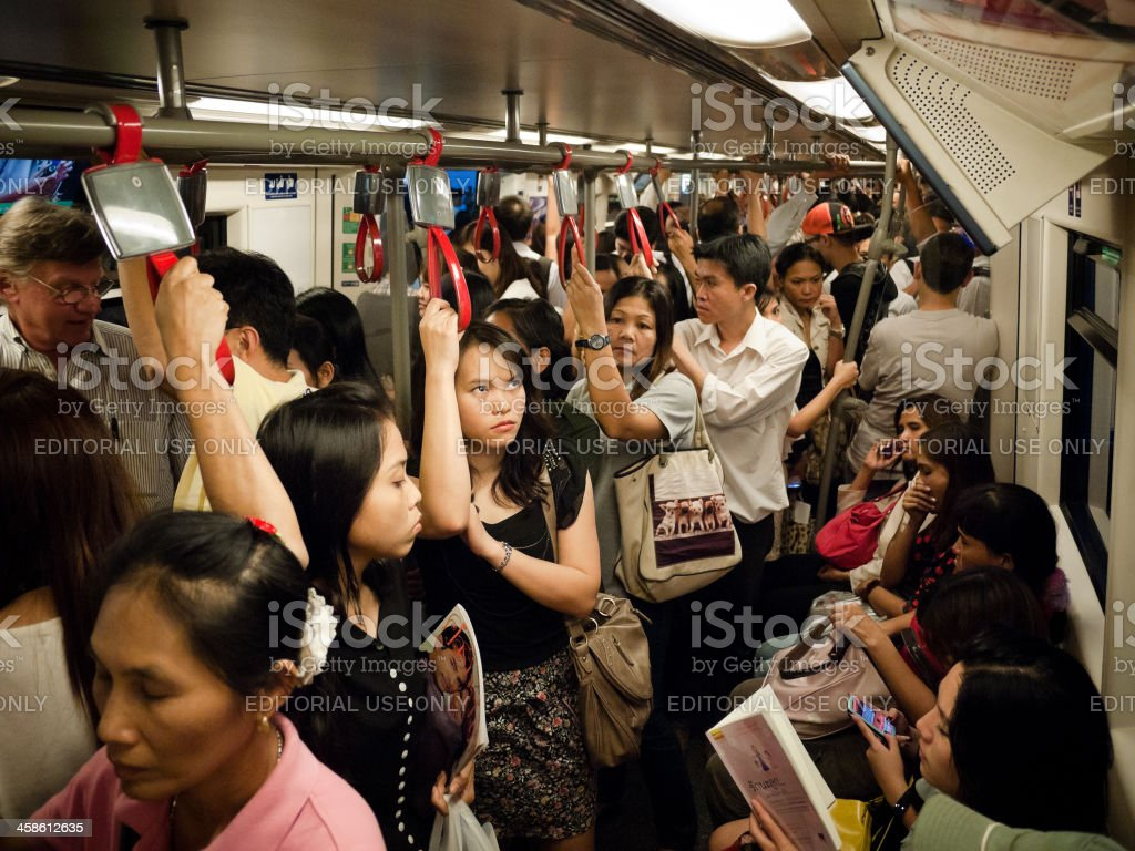 People traveling on a Train in Asia royalty-free stock photo