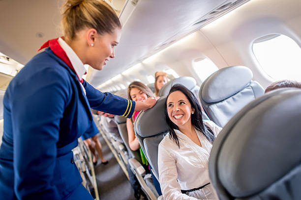 People traveling People traveling and enjoying the service onboard cabin crew stock pictures, royalty-free photos & images