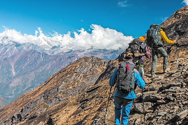 People travelling in Mountains on extreme Terrain – Foto