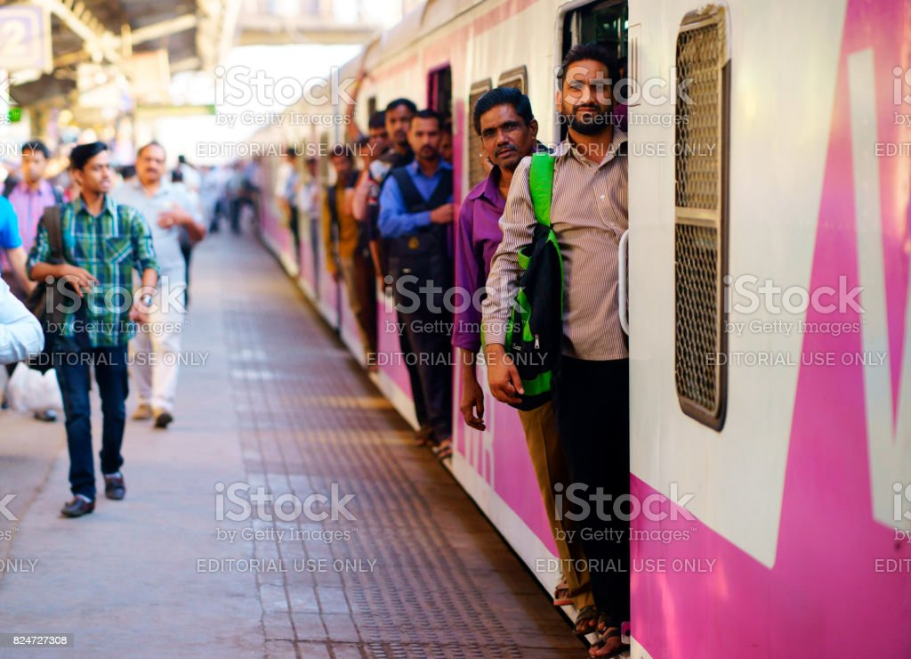 People travelling on local Indian train into Mumbai stock photo