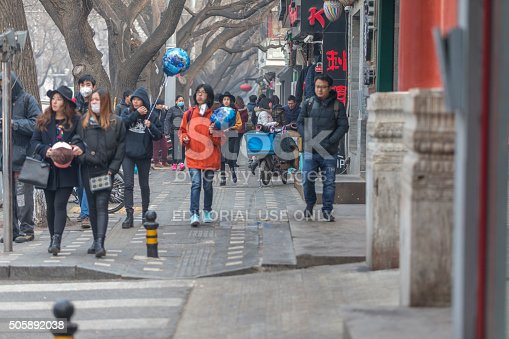 171300639istockphoto People under a heavy pollution day in Beijing 505892038