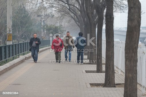 171300639istockphoto People under a heavy pollution day in Beijing 505892064