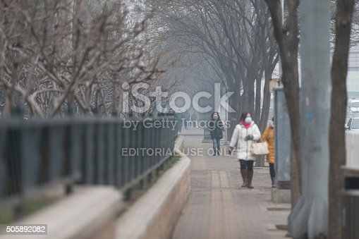 171300639istockphoto People under a heavy pollution day in Beijing 505892082