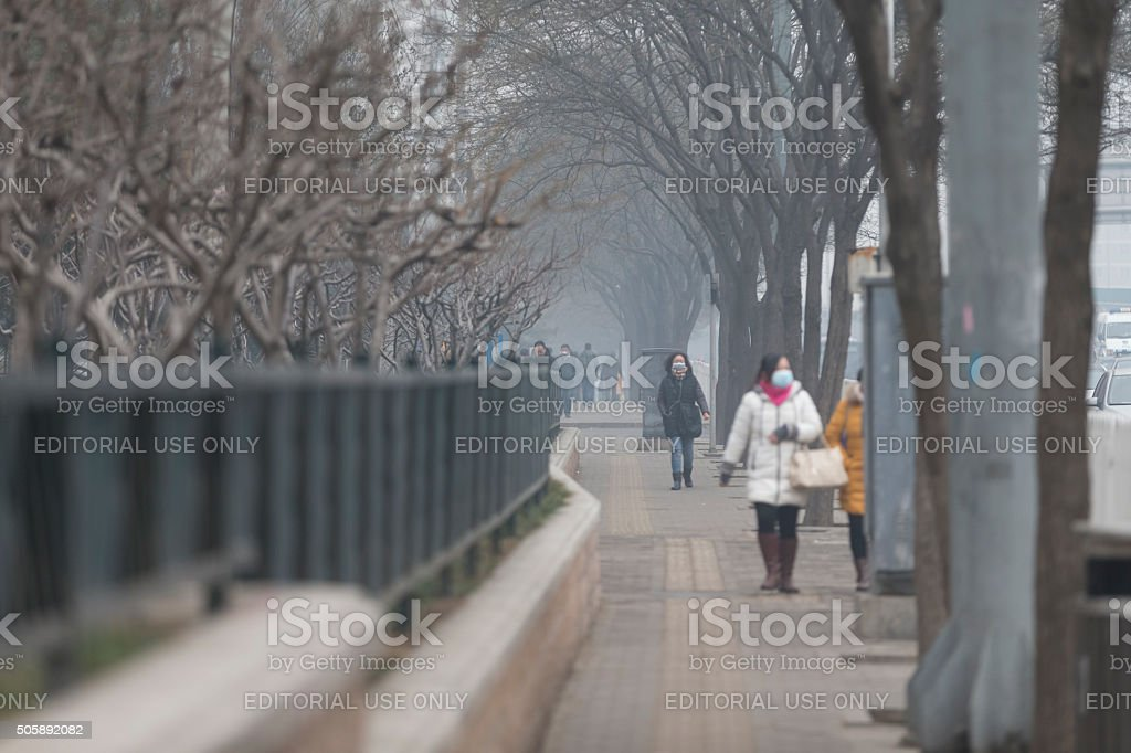 People under a heavy pollution day in Beijing stock photo