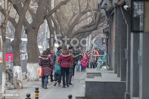 171300639istockphoto People under a heavy pollution day in Beijing 505896130