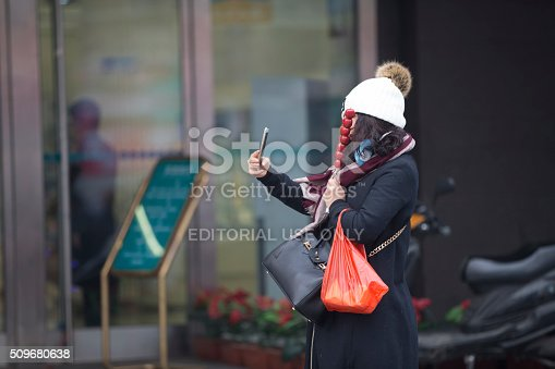 171300639istockphoto People under a heavy pollution day in Beijing 509680638