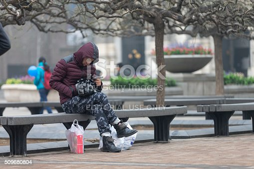 171300639istockphoto People under a heavy pollution day in Beijing 509680804