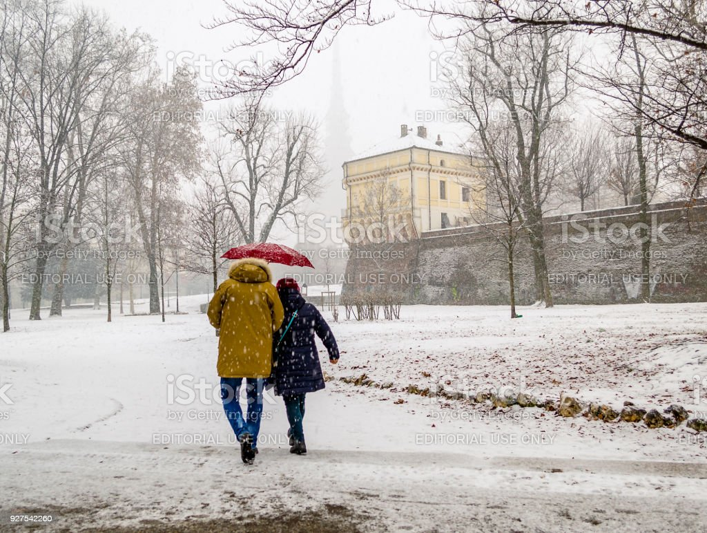 People under a heavy snowfall at the Giardini Reali in Turin (Piedmont, Italy). stock photo