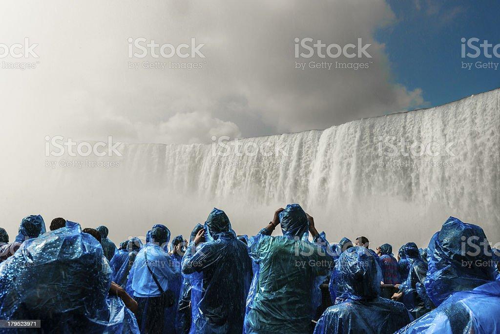 People under Niagara Falls stock photo