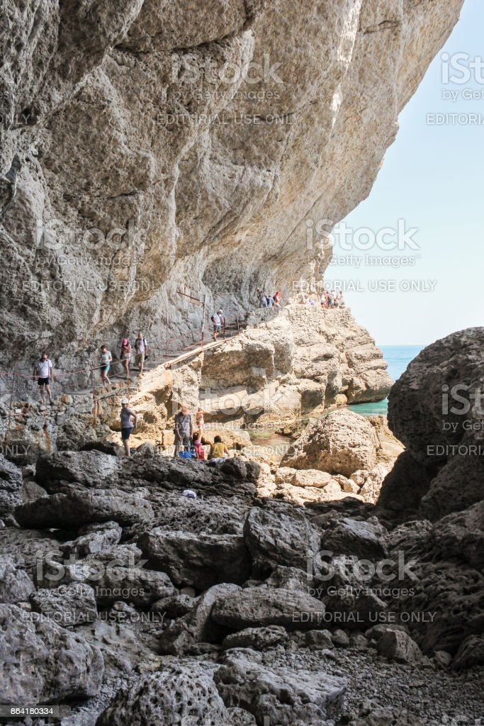 People under the rock. royalty-free stock photo