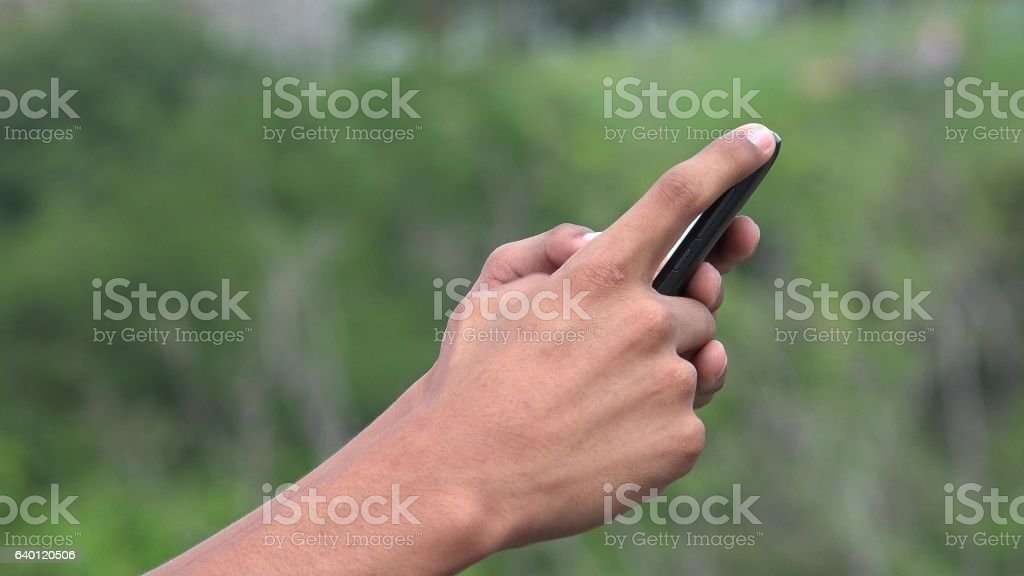 People Using A Smart Phone For Texting And Browsing Internet stock photo