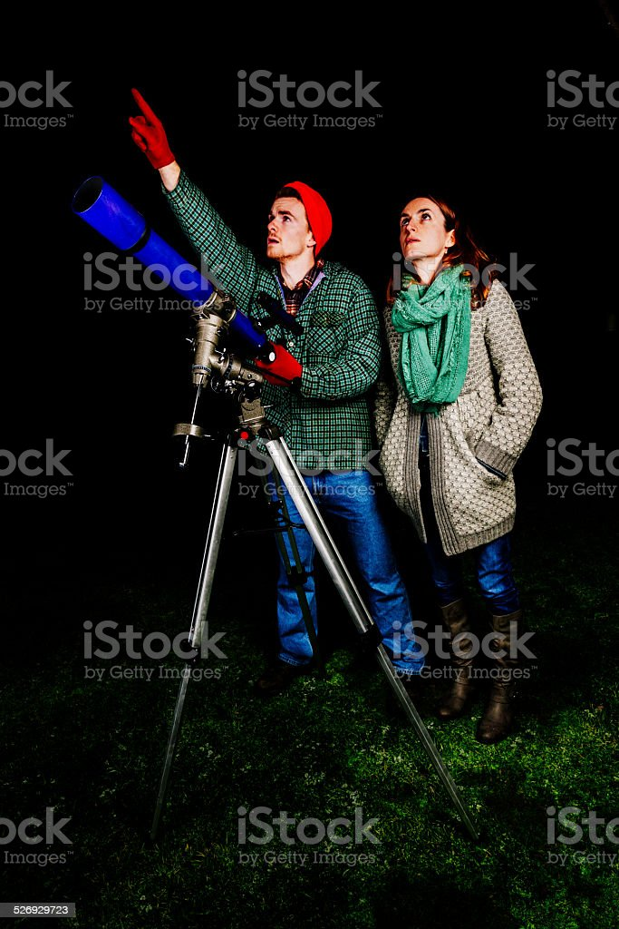 People using astronomical telescope stock photo