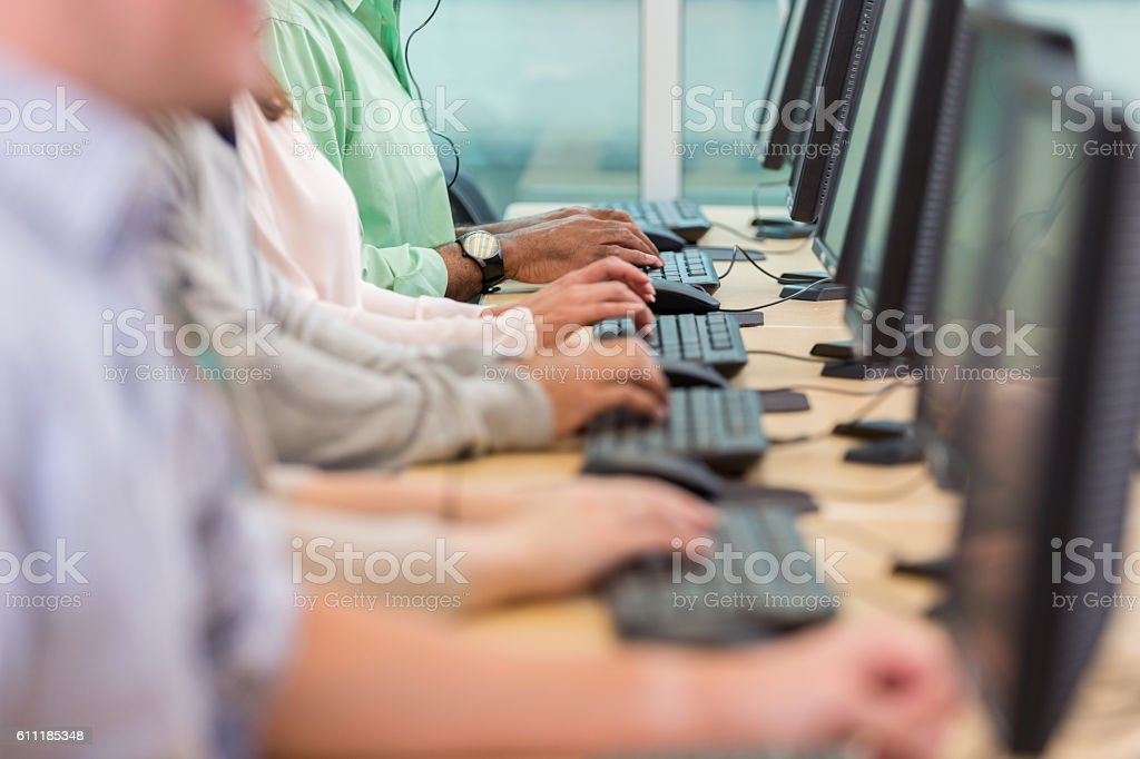 People using computers in call center stock photo