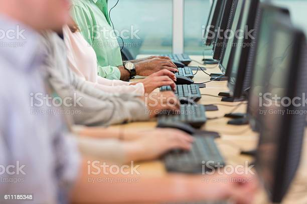 People Using Computers In Call Center - Fotografie stock e altre immagini di Adulto