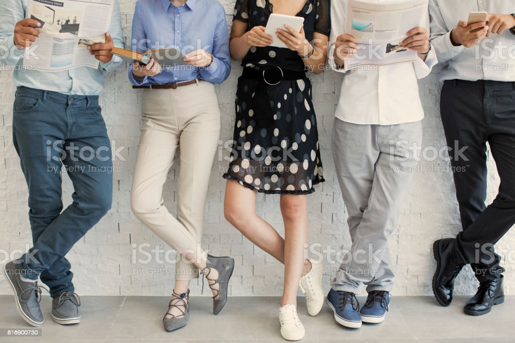 People using digital devices stock photo