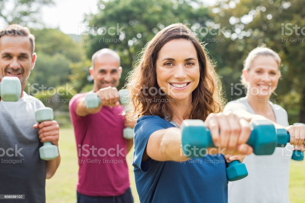 People using dumbbells stock photo
