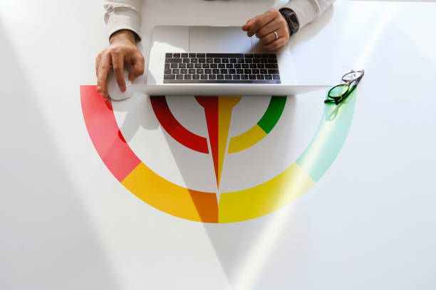 People Using Laptop and Credit Score Concept on Table stock photo