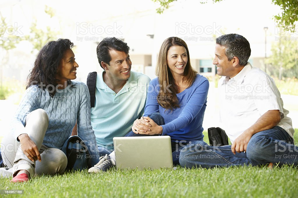 People using laptop outdoors royalty-free stock photo