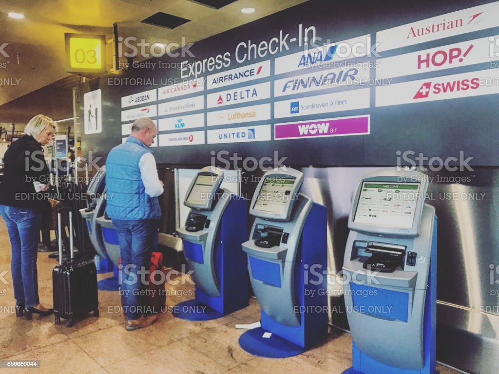 People using self check-in machines inside  Brussels Airport, Belgium stock photo