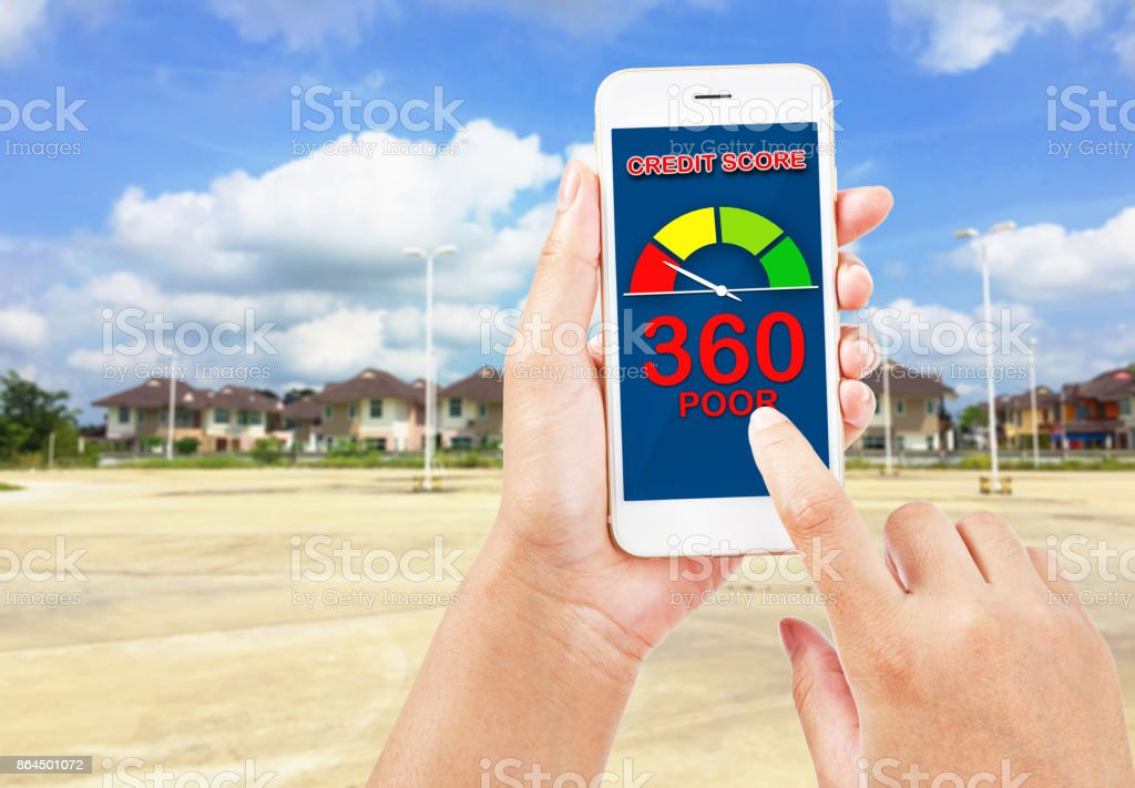 People using smartphone about credit score for buy real estate. stock photo