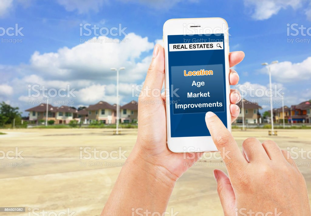 People using smartphone about real estate searching. stock photo