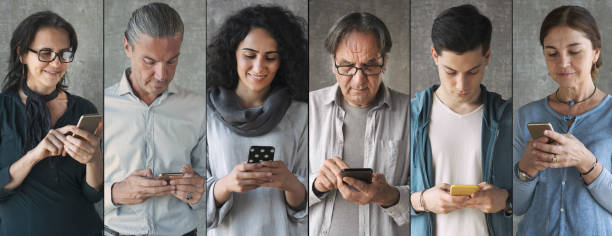 People using the mobile phone stock photo