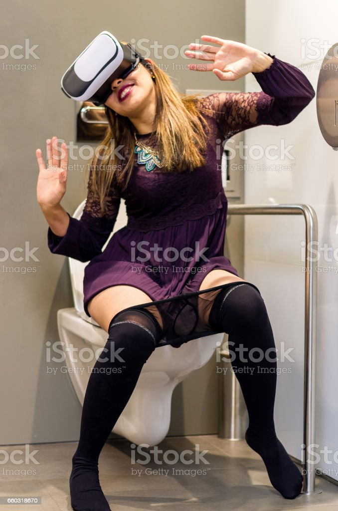 People Using Virtual Reality headset toilet vr stock photo