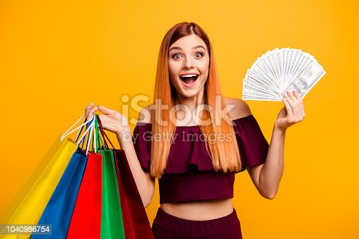 istock People victory party chic luck concept. Close up photo portrait of nice cheerful joyful pretty gorgeous with opened mouth lady showing advertising new shop isolated on bright background 1040986754