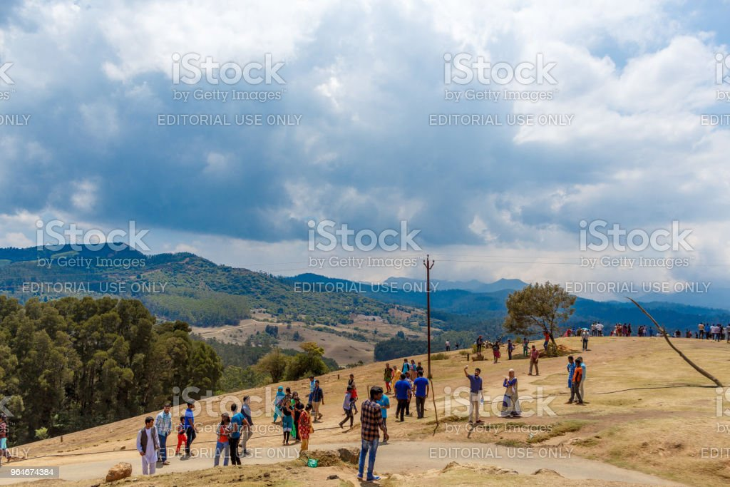 People viewing Mountains and clouds royalty-free stock photo