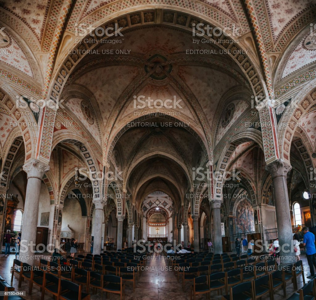 MILAN, ITALY - JULY 17, 2016: People visit Church of Santa Maria delle Grazie with 'The Last Supper' by Leonardo da Vinci. stock photo