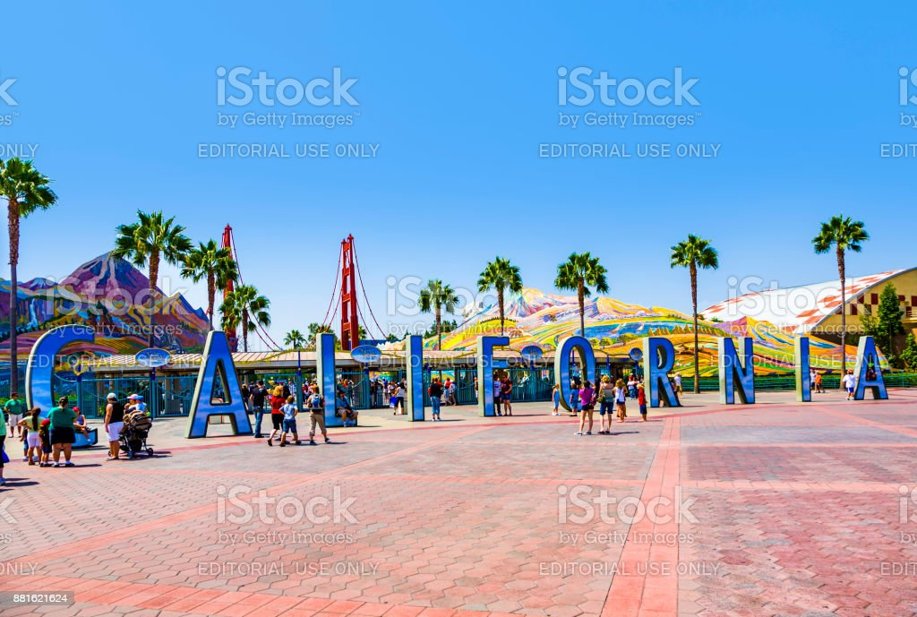 people visit disneyland and walk over commemorative bricks with names in terracotta stock photo