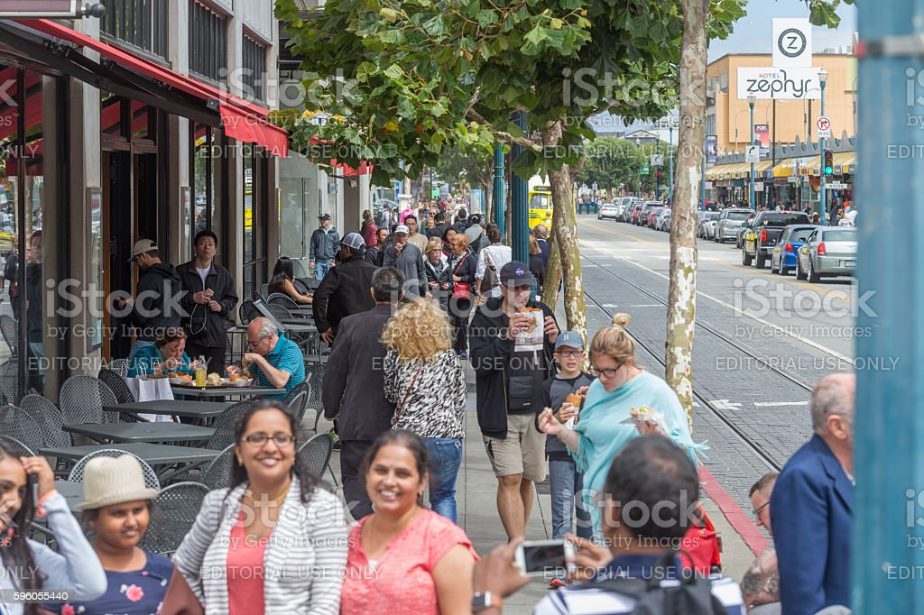 people visit Fishermans Wharf in San Francisco royalty-free stock photo