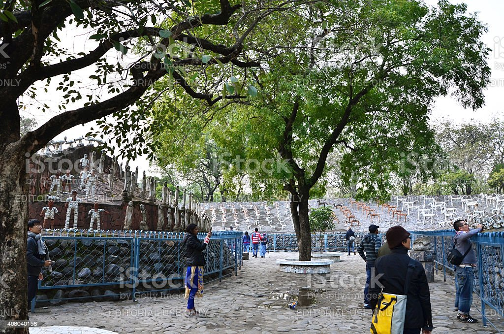 People visit Rock statues at rock garden in Chandigarh. stock photo