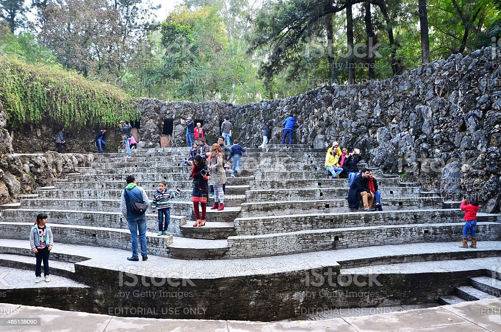 People visit Rock statues at the rock garden in Chandigarh. stock photo