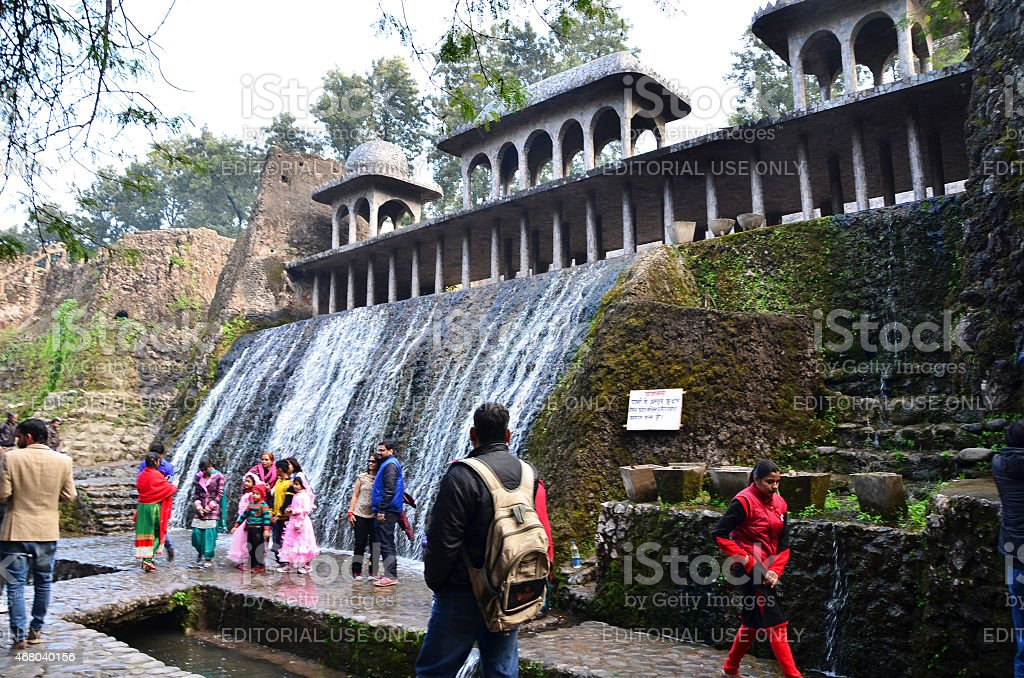 People visit Rock statues at the rock garden in Chandigarh stock photo