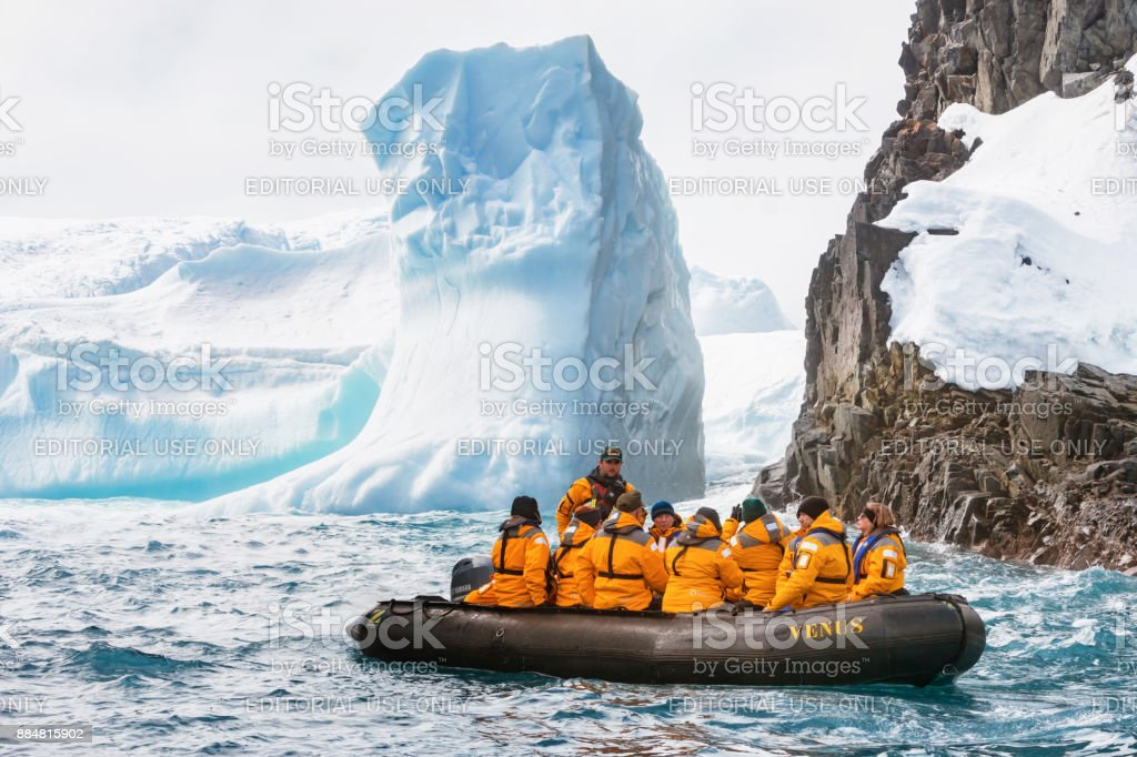 People visit the Antarctic coastline stock photo
